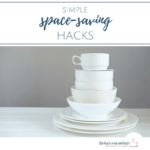 """Stack of white dishes on white surfaces and grey background. Text:""""Simple space-saving hacks"""""""