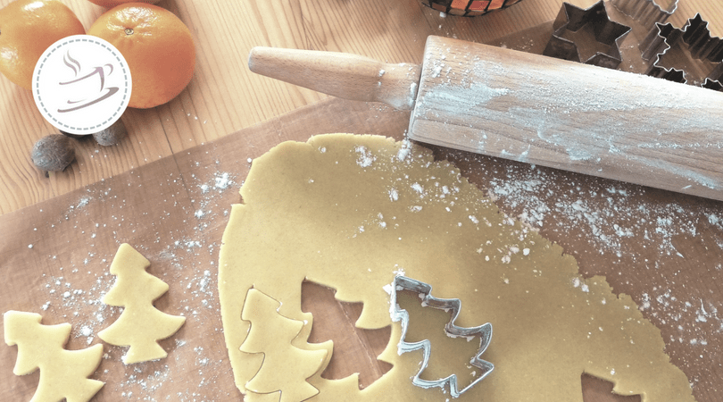 Christmas cookies with dough and cookie cutter